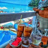 Photo taken at Almyra Beach Bar by Angela I. on 7/30/2016