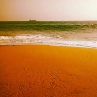 Photo taken at Kollam Beach by Xavier R. on 2/27/2014