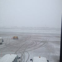 Photo taken at Gate C4 by Kelly B. on 4/18/2013