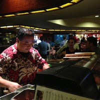 Photo taken at The Islands Sushi and Pupu Bar by Abigail G. on 8/19/2013