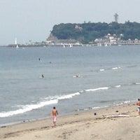 Photo taken at 稲村ヶ崎海岸 by Susumu I. on 7/21/2013