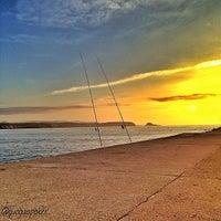 Photo taken at Playa de Salinas / San Juan de Nieva by GUAGUO I. on 6/23/2013