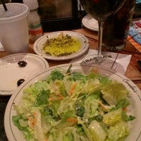 Photo taken at Carrabba's Italian Grill by Gina S. on 2/16/2013