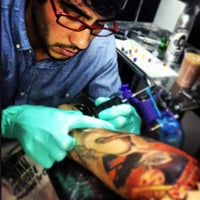 Photo taken at Amor Real - Custom Tattoo by Feelo V. on 12/20/2012