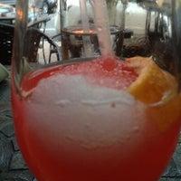 Photo taken at Manu's Tapas Bar & Sushi Lounge by Arthur H. on 7/14/2013