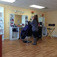 Photo taken at New Elegance Salon by Erick B. on 2/23/2013