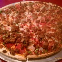 Photo taken at Tiny Tim's Pizza by Trent B. on 1/1/2013