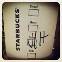 Photo taken at Starbucks by Ami N. on 3/28/2013