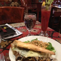 Photo taken at CAV Restaurant by Kevin V. on 1/1/2013