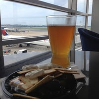 Photo taken at Delta Sky Club by Ryan E. on 6/16/2013