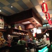 Photo taken at Yoshi Sushi by Ben W. on 8/12/2013