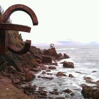 Photo taken at Peine del Viento by Oleg M. on 11/4/2012