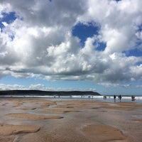 Photo taken at Woolacombe Beach by Nicky S. on 8/26/2014