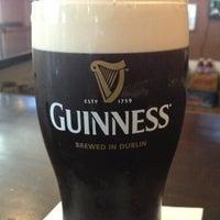 Photo taken at Tigín Irish Pub & Restaurant by Quinn T. on 7/8/2013