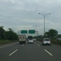 Photo taken at Jalan Tol Lingkar Luar Jakarta Seksi E1 (JORR E1) by Adhitia T. on 11/19/2012
