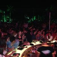 Photo taken at KafePi Beach Club by Ibrahim B. on 7/27/2013