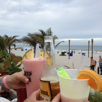 Photo taken at Coconuts on the Beach by Caitlin S. on 7/22/2013