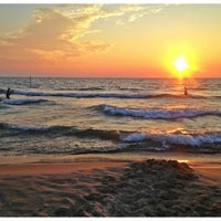 Photo taken at Holland State Park by Noel K. on 7/21/2013