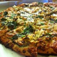 Photo taken at Arizmendi Bakery Panaderia & Pizzeria by Anil B. on 6/1/2013
