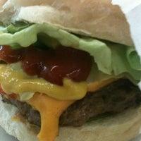 Photo taken at New Dog Hamburger by Paula T. on 10/26/2012