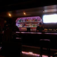 Photo taken at Equus Restaurant & Loungebar by Jay S. on 3/29/2013