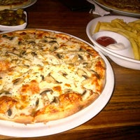 Photo taken at Paradise Pizza by Canip A. on 6/29/2014