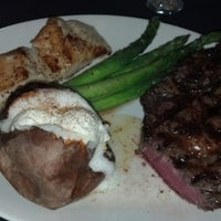 Photo taken at Stoney River Legendary Steaks by Nathan H. on 4/18/2013