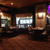 Photo taken at The Garlic Poet Restaurant & Bar by Clayton W. on 6/21/2013