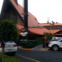 Photo taken at Hooters by Paty C. on 3/19/2013