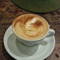 Photo taken at Zoka Coffee Roaster & Tea Company by Brian N. on 10/21/2012