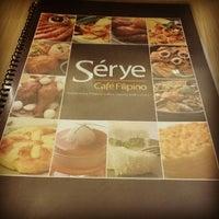 Photo taken at Sérye Café Filipino by Gene W. on 10/30/2014