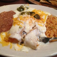 Photo taken at El Fenix by Amber M. on 12/29/2012