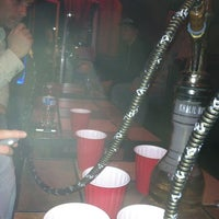 Photo taken at Arabian Nights Hookah Bar and Lounge by Alex Q. on 3/16/2013
