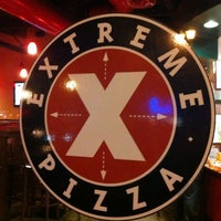 Photo taken at Extreme Pizza by Emily T. on 6/15/2013