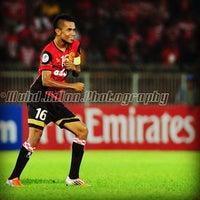 Photo taken at Stadium Sultan Muhammad IV by Mark Yie on 4/2/2013