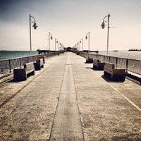 Photo taken at Belmont Veterans Memorial Pier by Kristofer V. on 3/11/2013