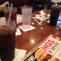 Photo taken at Wild Wing Cafe by Becca W. on 1/1/2014