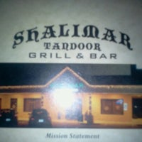 Photo taken at Shalimar Tandoor Grill & Bar by Angie A. on 10/16/2012