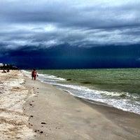 Photo taken at Bonita Beach by Enrique on 7/6/2013