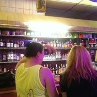 Photo taken at Ola's Liquors by kristina on 7/13/2014