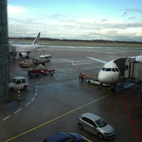 Photo taken at Gate B33 by Martin S. on 12/25/2012