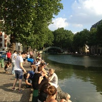 Photo taken at Canal Saint-Martin by Lee J. on 7/9/2013