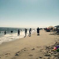 Photo taken at Rockaway Beach by Georgiana M. on 8/29/2016