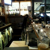 Photo taken at Okura Robata Sushi Bar and Grill by Lola C. on 6/16/2013