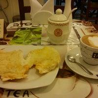 Photo taken at Café Petit by Sae K. on 10/10/2012