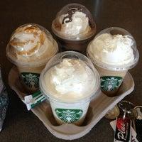 Photo taken at Starbucks by Emi G. on 5/12/2013