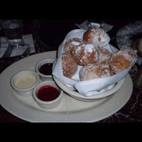 Photo taken at Grand Lux Cafe by Tracie M. on 1/30/2012