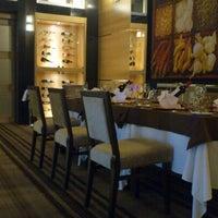 Photo taken at Tastes Fusion Restaurant by Mario A. on 8/15/2012