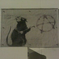 Photo taken at Banksy Mural: 'Glitter Glasses' Rat by Mike G. on 8/6/2011