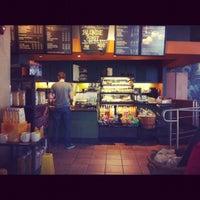 Photo taken at Starbucks by Olivier G. on 2/19/2012